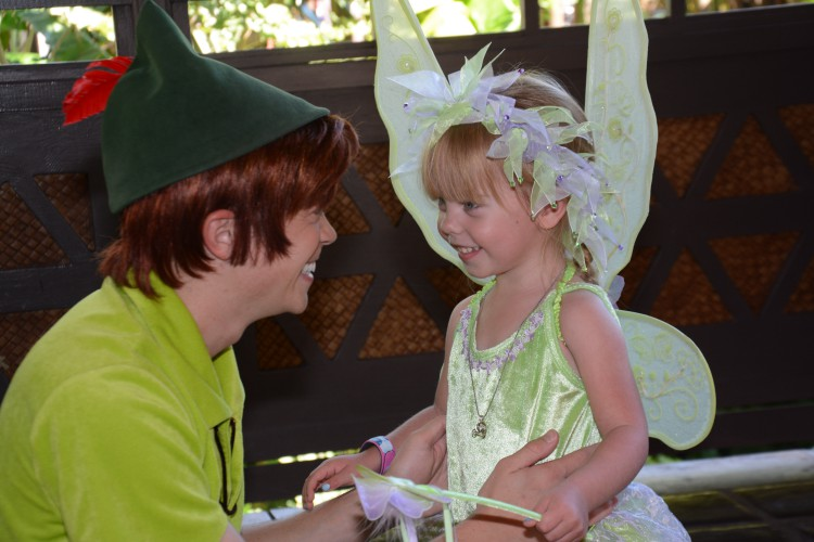 Peter Pan and Tinker Bell meeting at Disney World